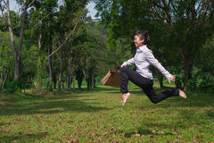 Business woman jump and dance outdoor Royalty Free Stock Photography