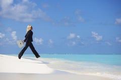 Business woman jump in ocean Stock Image