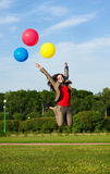 Business woman jumping with balloons Royalty Free Stock Image