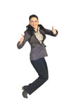 Business woman jumping and gives thumbs Royalty Free Stock Photo