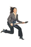 Business woman jumping with guitar Stock Photography
