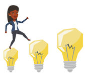 Business woman jumping on idea bulbs. Stock Image