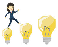 Business woman jumping on light bulbs. Royalty Free Stock Photos