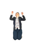 Business woman jumping and looking up Royalty Free Stock Image