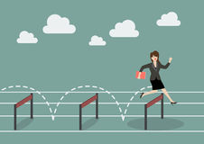 Business woman jumping over hurdle Royalty Free Stock Photography