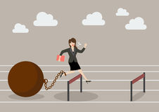 Business woman jumping over hurdle with the weight Royalty Free Stock Photos