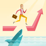 Business woman jumping over ocean with shark. Royalty Free Stock Photo