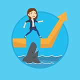 Business woman jumping over ocean with shark. Royalty Free Stock Image