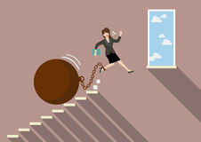Business woman jumping to freedom with heavy weight burden Royalty Free Stock Image