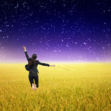 Business woman jumping in Yellow Rice fields and star Stock Images