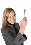 Business Woman with Key. A pretty business woman holding the key to success Royalty Free Stock Photos