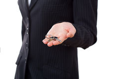 Business woman with key, focus on the keys. Business, real estate and banking concept - smiling businesswoman with house keys close-up Royalty Free Stock Image