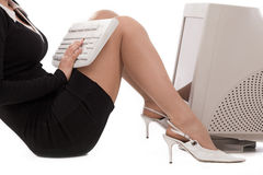 Business woman with a keyboard Royalty Free Stock Photography