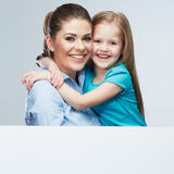 Business woman with kid girl isolated portrait behind white boa Royalty Free Stock Image