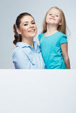 Business woman with kid girl isolated portrait behind white boa Stock Images