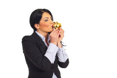 Business woman kissing piggy bank Royalty Free Stock Photography