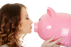 Business woman kissing a piggybank. Stock Photography
