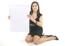 Business Woman kneeling with flip chart Stock Photo