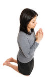 Business woman kneeling and praying Royalty Free Stock Photography