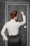 Business woman knock on door. Stylish business woman in the white blouse knock on drawing door royalty free stock photos