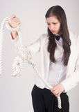 Business woman with knot of problem Royalty Free Stock Photography