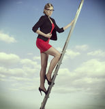 Business woman on ladder Stock Photos