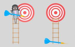 Business woman on ladder holding a blue dart. Dartboard. Isolated. stock photo