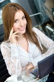 Business woman on a laptop Royalty Free Stock Images
