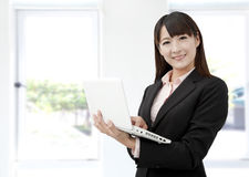 Business woman with laptop Stock Image