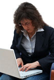 Business woman with laptop. Business woman writing on laptop royalty free stock image