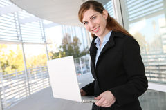 Business Woman with Laptop. A pretty young business woman with a laptop computer Royalty Free Stock Image