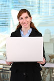 Business Woman with Laptop. A pretty young business woman with a laptop computer Stock Images