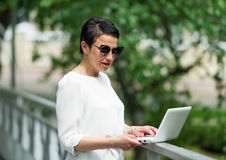The business woman with the laptop. Stock Images