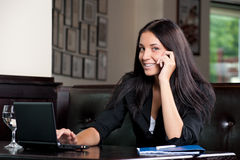 Business woman with a laptop and cell phone Royalty Free Stock Photos