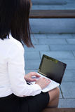 Business woman with laptop in city park Stock Photos
