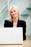 Business woman on a laptop computer Stock Image