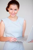 Business woman with laptop computer Stock Photos