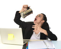 Business woman at laptop computer desk drinking coffee excited and anxious in caffeine addiction. Young attractive business woman at laptop computer desk Stock Photo