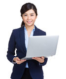Business woman with laptop computer Stock Images