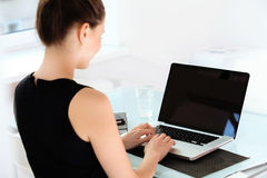 Business Woman with a laptop at the оffice Stock Photo