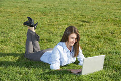 A business woman on a laptop in a field Royalty Free Stock Photography