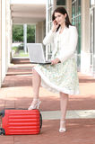 Business Woman with Laptop on the Go, Traveling Royalty Free Stock Photo