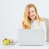 Business Woman With Laptop. Happy business woman with laptop in office Royalty Free Stock Photos