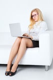 Business Woman With Laptop. Happy business woman with laptop in office Royalty Free Stock Images