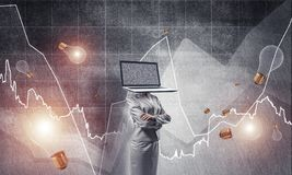 Business woman with laptop instead of head. Business woman in suit with laptop instead of head keeping arms crossed while standing against flying bulbs and Royalty Free Stock Photo