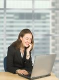 Business woman on laptop in her office Stock Photos
