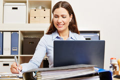 Business woman with laptop in her office Stock Photos