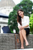 Business woman on laptop in Hong Kong Royalty Free Stock Image