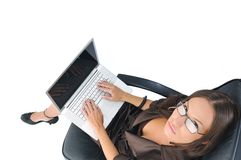 Business woman with laptop isolated on white Royalty Free Stock Photography