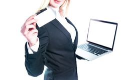 Business woman with laptop isolated on white background. Holding business card. Stock Photo